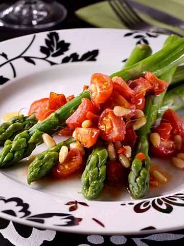 Asparagus and tomato salad with pinenuts