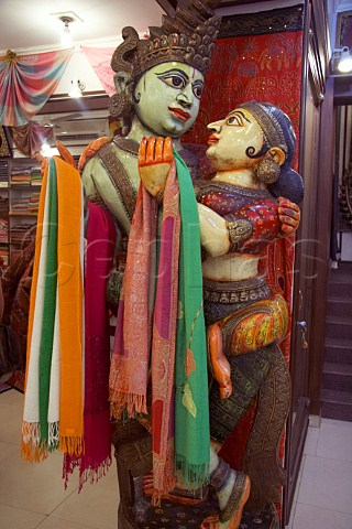 Pashmina shawls for sale on a Indian staue in Euphoria Arts Emporium Government of India recognised shop in Jew Town Mattancherry Kochi Cochin Kerala India