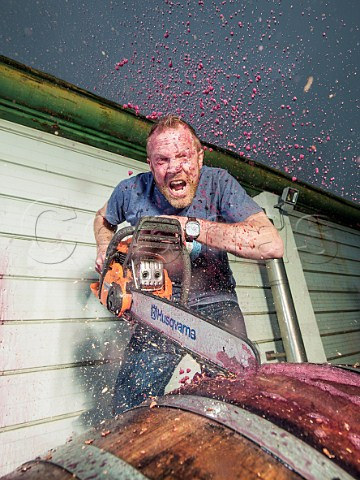 Grant Phelps chainsaws a barrel of wine Casas del Bosque Casablanca Valley Chile