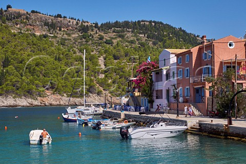 Village of Assos with houses and taverna overlooking its bay and the castle atop its peninsula Cephalonia Ionian Islands Greece